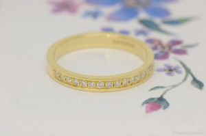 Bespoke 18ct yellow gold and diamond eternity ring by Macdara Ó Graham