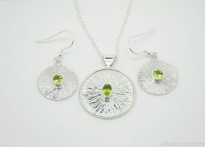 Peridot sun disc earrings and necklace by Macdara Ó Graham